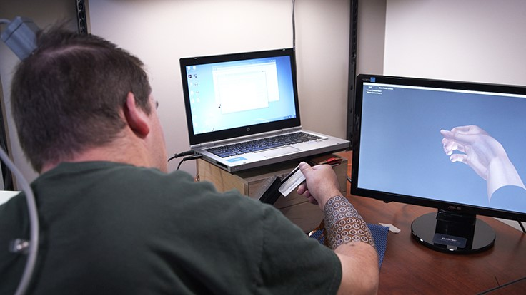Medical device, brainwaves retrain paralyzed hand