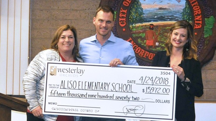 Westerlay Orchids donates almost $16,000 to classes in Aliso Elementary School