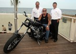 OCC's Paul Teutel Sr. Presents Custom-Built Chopper to Feather Free Zone