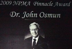 Dr. John Osmun Recognized with Pinnacle Award at PestWorld