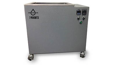Ultrasonic cleaning system uses two technologies