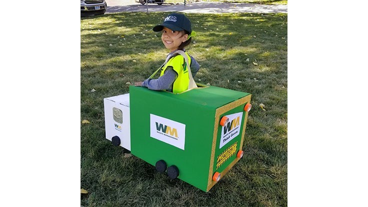 Kids dress up as Waste Management truck drivers