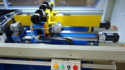 Gundrilling machine with servo-driven fixturing option
