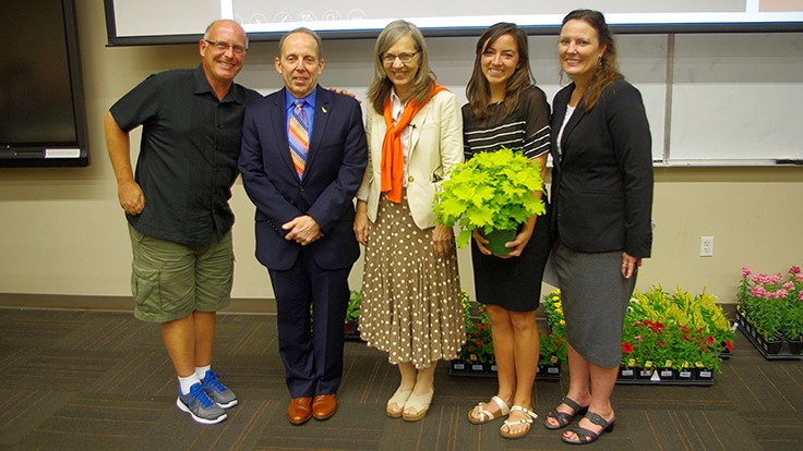 Professor gives student 40,000th plant